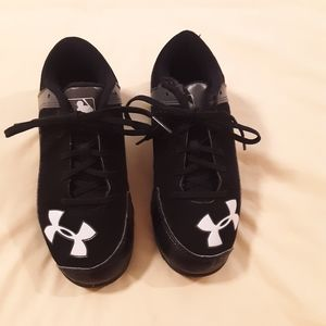 Under Armour baseball cleats.